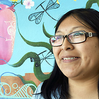 """Zuni artist Mallery Quetawki, 33, was commissioned to paint a mural for the Zuni Community Park. Her mural """"Water is Life"""" features the cycle of water, from rain to evaporation, to the its connection with human life. Quetawki is the daughter of former Zuni Gov. Arlen Quetawki, who is currently a member of the Zuni Tribal Council."""