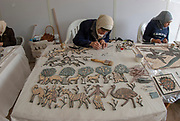 Women make an intricate mosaic design at a mosaic and handicraft workshop, Madaba , Jordan