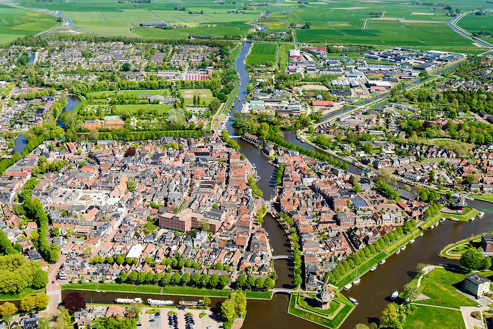 Nederland, Friesland, Gemeente Dongeradeel, 07-05-2018; overzicht Dokkum, met stadswallen en bolwerken, inclusief vestingmolens en bastions. Kleistreek met Waddenzee an de horizon.<br /> Overview Dokkum, with ramparts and strongholds, including city windmills and bastions.<br /> <br /> luchtfoto (toeslag op standaard tarieven);<br /> aerial photo (additional fee required);<br /> copyright foto/photo Siebe Swart