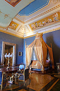 """""""The Bedroom of Francis II"""". The room furnished with a four poster bed, chest of drawers and table in the Empire Style in mahogany & gilt. The vaulted ceiling is freaked with an allegory of the victory of Napoleon over the Bourbons: the Glory of Thesus slaying the Minataur, by Giuseppe Cammarano  .  The Bourbon Kings of Naples Royal Palace of Caserta, Italy. A UNESCO World Heritage Site .<br /> <br /> Visit our ITALY HISTORIC PLACES PHOTO COLLECTION for more   photos of Italy to download or buy as prints https://funkystock.photoshelter.com/gallery-collection/2b-Pictures-Images-of-Italy-Photos-of-Italian-Historic-Landmark-Sites/C0000qxA2zGFjd_k<br /> <br /> <br /> Visit our EARLY MODERN ERA HISTORICAL PLACES PHOTO COLLECTIONS for more photos to buy as wall art prints https://funkystock.photoshelter.com/gallery-collection/Modern-Era-Historic-Places-Art-Artefact-Antiquities-Picture-Images-of/C00002pOjgcLacqI"""