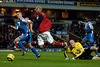 Fotball<br /> England 2004/2005<br /> Foto: SBI/Digitalsport<br /> NORWAY ONLY<br /> <br /> Blackburn v Bolton, FA Barclays Premiership, Ewood Park, 24/01/05<br /> <br /> Bolton's El Hadji Diouf suddenly goes flailing through the air as a bemused Brad Friedel looks on, earning the penalty.