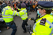 Police officers use pepper spray against protestors while his colleagues scuffles and argue with demonstrators during clashes following a 'Kill the Bill' protest outside the Houses of Parliament in London on Saturday, April 3, 2021. Projectiles were thrown as police pushed protesters away, and dozens of extra officers were brought in to help unblock the road for a McDonald's lorry held up outside parliament. (Photo/ Vudi Xhymshiti)