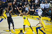Golden State Warriors forward Kevon Looney (5) defends Milwaukee Bucks forward Khris Middleton (22) at Oracle Arena in Oakland, Calif., on March 29, 2018. (Stan Olszewski/Special to S.F. Examiner)