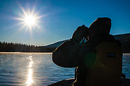 Glassing from the boat, looking for the spash of white, from a bull moose rack.