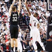 25 April 2016: Los Angeles Clippers forward Blake Griffin (32) takes a jump shot over Portland Trail Blazers forward Maurice Harkless (4) during the Portland Trail Blazers 98-84 victory over the Los Angeles Clippers, during Game Four of the Western Conference Quarterfinals of the NBA Playoffs at the Moda Center, Portland, Oregon, USA.
