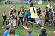 Middletown, New York - Counselors and children from the Middletown YMCA summer camp perform during a talent show for parents and other campers on August 17, 2010.