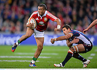 25 June 2013; Simon Zebo, British & Irish Lions, escapes the tackle of Tom English, Melbourne Rebels. British & Irish Lions Tour 2013, Melbourne Rebels v British & Irish Lions. AAMI Park, Olympic Boulevard, Melbourne, Australia. Picture credit: Stephen McCarthy / SPORTSFILE
