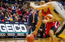 Dec 1, 2018; Morgantown, WV, USA; Youngstown State Penguins head coach Jerrod Calhoun watches on during the first half against the West Virginia Mountaineers at WVU Coliseum. Mandatory Credit: Ben Queen-USA TODAY Sports