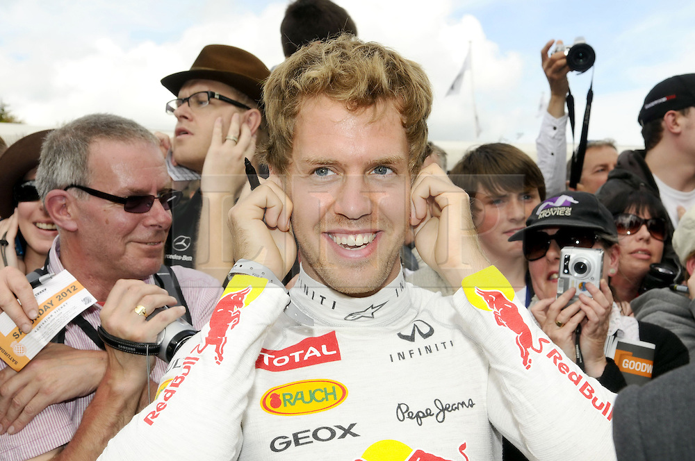 © Licensed to London News Pictures. 30/06/2012 .Sebastian Vettel  at The Goodwood Festival of Speed..The Goodwood Festival of Speed is the largest motoring garden party in the world - a unique summer weekend, The largest car culture event in the world. Held in the grounds of Goodwood House,Chichester..Photo credit : Grant Falvey/LNP