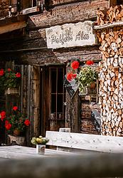 THEMENBILD - der Eingang der Palfner Alm ist mit roten Geranien liebevoll dekoriert. Die Alm wurde im Jahr 1730 erbaut, 2017 teilweise renoviert und liegt auf 1.330 m im Seidlwinkltal in Rauris, aufgenommen am 09. September 2018, Rauris, Österreich // The entrance to the Palfneralm is lovingly decorated with red geraniums. The Alm was built in 1730, partly renovated in 2017 and is located at 1,330 m in the Seidlwinkltal in Rauris on 2018/09/09, Rauris, Austria. EXPA Pictures © 2018, PhotoCredit: EXPA/ Stefanie Oberhauser