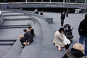 Lunchtime people occupy the design landscape of More London on London's Riverside, near Tower Bridge.