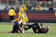 Los Angeles Rams defensive end Aaron Donald (99) leaps over San Francisco 49ers quarterback Brian Hoyer (2) after sacking the QB as San Francisco 49ers offensive tackle Joe Staley (74) falls backward on a game clinching play late in the fourth quarter during the 2017 NFL week 3 regular season football game against the against the San Francisco 49ers, Thursday, Sept. 21, 2017 in Santa Clara, Calif. The Rams won the game 41-39. (©Paul Anthony Spinelli)