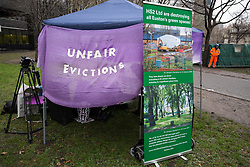 London, UK. 12th January, 2018. An anti-HS2 stall is pictured in Euston Square Gardens. Local residents and environmental campaigners are protesting against the planned felling of mature London Plane, Red Oak, Common Whitebeam, Common Lime and Wild Service trees in Euston Square Gardens to make way for temporary sites for construction vehicles and a displaced taxi rank as part of preparations for the HS2 high-speed rail line.