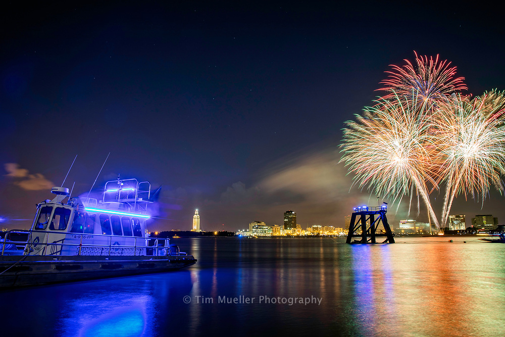 The annual Fourth of July WBRZ's Fireworks on the Mississippi show lights up the Baton Rouge skyline Tuesday evening along the Mississippi River at the Dal-Co launch services site in Port Allen, La.
