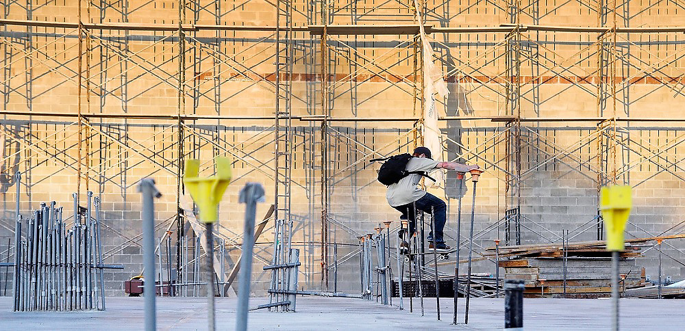 Trevor Fenner skateboards through a construction site in Seattle, Washington on August 5, 2007. Fenner, who grew up in Seattle, now lives in Los Angeles and came back for the summer to look for work.