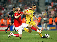 Photo: Chris Ratcliffe.<br /> <br /> Switzerland v Ukraine. 2nd Round, FIFA World Cup 2006. 26/06/2006.<br /> <br /> Andriy Shevchenko of Ukraine is tackled by Ludovic Magnin of Switzerland.