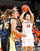 Nov. 14, 2010; Charlottesville, VA, USA; Virginia guard Kelsey Wolfe (10) shoots the ball in front of Mount St. Mary's forward Mary Dunn (24) and Mount St. Mary's forward Rachel Mathews (45) during the game at the John Paul Jones Arena. Virginia won 81-58. Mandatory Credit: Andrew Shurtleff-