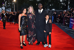 Director Steve McQueen with wife Bianca Stigter and their children Alex McQueen and Dexter McQueen arriving for the 62nd BFI London Film Festival Opening Night Gala screening of Widows held at Odeon Leicester Square, London.