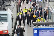 Zijne Majesteit Koning Willem-Alexander opent donderdagmiddag 13 maart officieel het nieuwe treinstation Rotterdam Centraal.De nieuwbouw van het spoordeel, de stationshal en directe omgeving duurde in totaal 9 jaar en kostte ruim 657 miljoen euro.Meest opvallende onderdeel van de nieuwbouw is het forse, spiegelende puntdak van roestvrij staal dat in de richting van het centrum wijst.Het gebouw kreeg daarom de bijnaam 'station kapsalon'. De naam verwijst naar het bakje waarin een Rotterdamse snack wordt geserveerd.<br /> <br /> His Majesty King Willem-Alexander opened Thursday afternoon March 13 officially the new Rotterdam Centraal.De railway station building cost more than 657 million euro.Most striking part of the new building is the large, reflective stainless steel gabled roof pointing towards the center.The building was therefore nicknamed 'Kapsalon'. The name refers to the container in which a Rotterdam snack is served.<br /> <br /> Op de foto / On the photo:  Koning Willem Alexander krijgt een rondleiding over het nieuwe station / King William Alexander gets a tour of the new station