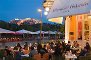 Guests at the Athinaion Politeia Cafe? in Thission enjoy a great sunset view of the Acropolis.