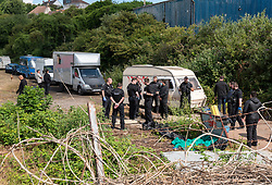 © Licensed to London News Pictures; 13/06/2020; Bristol, UK. New travellers face eviction from the old gas works site on Glenfrome Road after bailiffs from GRC arrived on Saturday morning with police also in attendance who have closed off the road. The travellers have been living on the site, which is owned by Wales and West Utilities, for some weeks, and say that the eviction is illegal and is being done without any court papers. The travellers have been told that this is a common law eviction, but they say it is illegal because there is building on the land (hidden by foliage) which is permanently occupied and so the land is ancillary to the building and so a possession order must be granted by a court before an eviction can take place, and that no possession order has been granted. Photo credit: Simon Chapman/LNP.
