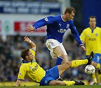Photo. Aidan Ellis.<br /> Everton v Birmingham City.<br /> FA Barclaycard Premiership.<br /> 28/12/2003.<br /> Everton's Duncan Ferguson is tackled by Birmingham's Matthew Upson