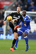 Glenn Murray of Brighton is challenged by Sol Bamba of Cardiff city. EFL Skybet championship match, Cardiff city v Brighton & Hove Albion at the Cardiff city stadium in Cardiff, South Wales on Saturday 3rd December 2016.<br /> pic by Andrew Orchard, Andrew Orchard sports photography.