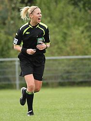 FODBOLD: Dommer Mathilde Abildgaard under kampen i 3F Ligaen mellem Taastrup FC og OB den 12. maj 2012 i Taastrup Idrætspark. Foto: Claus Birch