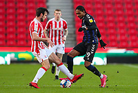 Middlesbrough's Djed Spence battles with Stoke City's Morgan Fox<br /> <br /> Photographer Alex Dodd/CameraSport<br /> <br /> The EFL Sky Bet Championship - Stoke City v Middlesbrough - Saturday 5th December 2020 - bet365 Stadium - Stoke-on-Trent<br /> <br /> World Copyright © 2020 CameraSport. All rights reserved. 43 Linden Ave. Countesthorpe. Leicester. England. LE8 5PG - Tel: +44 (0) 116 277 4147 - admin@camerasport.com - www.camerasport.com