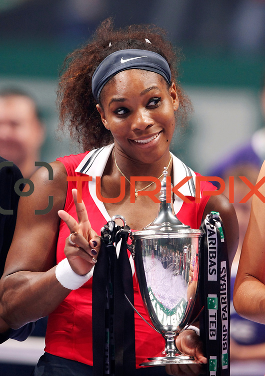 Serena Williams of the U.S. celebrates with the trophy after her victory against Russia's Maria Sharapova after their final WTA tennis championships match in Istanbul, October 28, 2012.  Photo by Aykut AKICI/TURKPIX