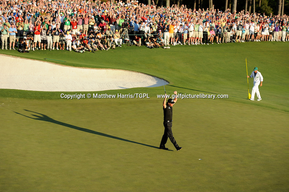 Phil MICKLESON (US) birdies 18th to win by 3 shots for his third green jacket during fourth round US Masters 2010, Augusta National, Augusta,Georgia,USA.