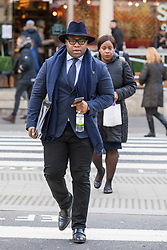 © Licensed to London News Pictures. 23/02/2018. London, UK. Lanre Haastrup (L), followed by his wife, Takesha Thomas (R), parents of 11-month-old Isaiah Haastrup, arrive at the High Court in London. Judges are set to rule on whether doctors at King's College Hospital can withdraw life support for Isaiah who suffered severe brain damage. Photo credit: Rob Pinney/LNP