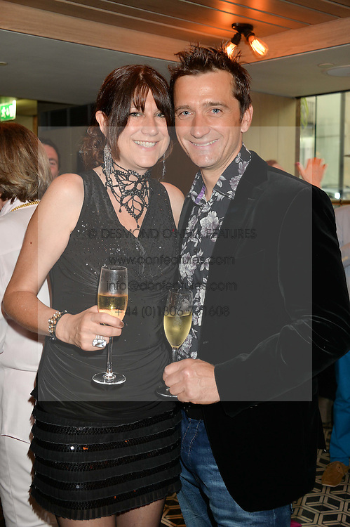 Skier GRAHAM BELL and his wife SARAH at Henry Conway's 31st birthday party held at the Pont St Restaurant, Belgraves Hotel, London on 12th July 2014.