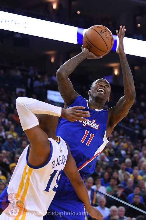 November 5, 2014; Oakland, CA, USA; Los Angeles Clippers guard Jamal Crawford (11) shoots the basketball against Golden State Warriors guard Leandro Barbosa (19) during the first quarter at Oracle Arena.
