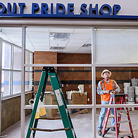 010714       Cable Hoover<br /> <br /> Sign artist Steve Cunningham tapes a template for the Scouts logo onto the window of the gift inside the Fighting Scouts Events Center in Ft. Defiance Tuesday. The $37 million, 6,500-seat arena is set to open January 22. The Scouts will face the Paige Sundevils in the venue's first match January 25.