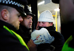 © under license to London News Pictures. A protetstor is involved in a scuffle with the police as the Save EMA (Educational Maintenance Allowance) protest ends in Victoria St, London outside the Department for Innovation and Skills (13/12/10) Photo credit should read: Olivia Harris/ London News Pictures