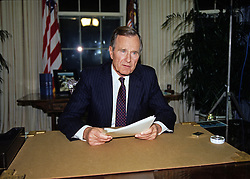 United States President George H.W. Bush poses for photographers after making an address to the nation on the civil disturbances in Los Angeles, California following the Rodney King verdict from the Oval Office of the White House in Washington, DC on May 1, 1992. Photo by Arnie Sachs / CNP /ABACAPRESS.COM