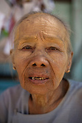 Woman with Thanaka in her face. Thanka is a natural face Powder very common in Myanmar, it is belived to the skin protect from the sun.<br /> Note: These images are not distributed or sold in Portugal