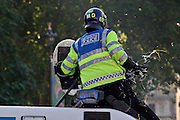 London, England, 15/09/2004..An estimated 20,000 hunt supporters demonstrate in Parliament Square as a new bill to ban hunting with dogs is passed. Some demonstrators fought with riot police, and five hunt supporters managed to get onto the House of Commons floor during the debate..A policeman is struck by an egg thrown by a demonstrator.