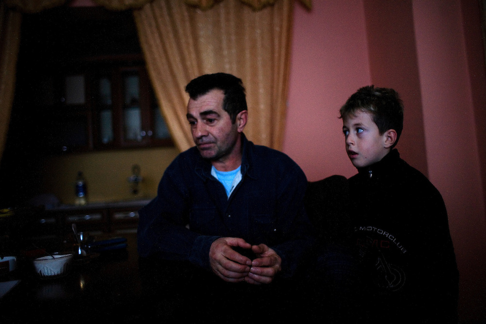 Reshat Zatriqi, 48, sits in his home in Mitrovica with his son. He is worried about the violence that happens near his house in northern Mitrovica in one of the only Albanian neighborhoods. On December 30 2008 a nearby store was burned and on February 14 2009 there was a bomb or grenade explosion at a friend's house a few hundred meters away.<br /> <br /> Mitrovica, February 15, 2009.