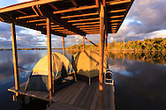 Sunrise greets boat campers who have spent the night in their tents on a chickee platform on the Wilderness Waterway in Everglades National Park, Florida.<br /> WATERMARKS WILL NOT APPEAR ON PRINTS OR LICENSED IMAGES.<br /> <br /> Licensing: https://tandemstock.com/assets/34304101