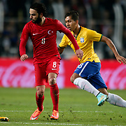 Turkey's Selcuk inan (L) and Brazil's Roberto Firmino (R) during their a international friendly soccer match Turkey betwen Brazil at Sukru Saracoglu Arena in istanbul November 12, 2014. Photo by Aykut AKICI/TURKPIX