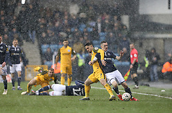 Beram Kayal of Brighton and Hove Albion and Shaun Williams of Millwall tussle for the ball during a hail storm - Mandatory by-line: Arron Gent/JMP - 17/03/2019 - FOOTBALL - The Den - London, England - Millwall v Brighton and Hove Albion - Emirates FA Cup Quarter Final