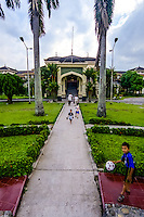 Indonesia, Sumatra. Medan. Istana Maimun Palace was built in 1888 by the sultan of Deli. His ancestors still occupy one wing of the building. Children playing outside the palace.