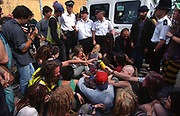 Road Protesters and police confrontations at Cradlewell bypass within Jesmond, Newcastle upon Tyne, England. In 1993 work began on a bypass for the Cradlewell area, replacing the very steep Benton Bank as the main thoroughfare.<br /><br />The British Road Protesters movement began in the early 1990s when the Donga tribe squatted Twyford Down to save this beautiful site, a site of scientific interest SSI from the Ministry of transport's road building programme which threatened to destroy the landscape. The Dongas was the name of the ancient walkways, the paths trodden in the middle ages by people walking down to Winchester. A small tribe were joined by people of all walks of life who came to Twyford Down to defend it. A long hard battle over several years ended in the 'cutting' a new motorway built through this ancient monument and destroying it. <br /><br />The Road Protest movement in Britain continued for many years and more battles were fought in London against the MII both at Wanstead then in Leytonstone, and subsequently at Newbury, and in Sussex. the protesters were very inventive in their use of non violent peaceful direct action. They barricaded themselves into squats, made tree houses, tunnels and have huge demonstrations against the bailliffs, police and security who tried to force their way through the defences of this alternative environmental popular movement. Many of the roads were built eventually and many sites of great beauty lost, but the government had to stand down from its road building policy and eventually the programme was halted. the protests cost the government billions. Out of that movement grew many environmental NGOs who have to this day kept fighting for ecological and sustainable environmental solutions rather than following the cult of the car, petrol and roadbuilding..