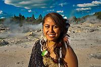 A young Maori woman (with the Pohutu Geyser behind), Te Puia (New Zealand Maori Arts & Crafts Institute), Rotorua, New Zealand