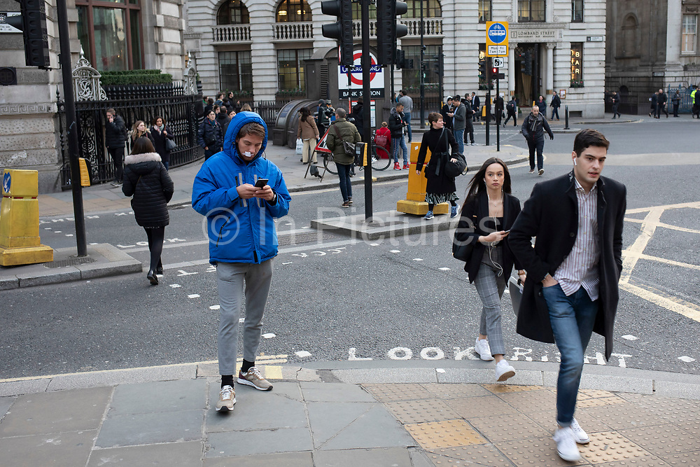 Man with a plaster on his upper lip in the City of London on 5th February 2020 in London, England, United Kingdom. The City of London is a city, county and a local government district that contains the historic centre and the primary central business district CBD of London.