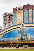 Propaganda images of Hassanal Bolkiah, the Sultan of Brunei, atop the Parade ground or Taman Haji Sir Muda Omar Ali Saifuddien and surrounding buildings, Bandar Seri Begawan, Brunei