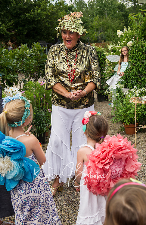 """The """"Golden"""" Fairy welcomes Morgan and Hailey Brooks to Fairy Night at Cackleberries Garden Center in Meredith Wednesday evening.  (Karen Bobotas/for the Laconia Daily Sun)"""