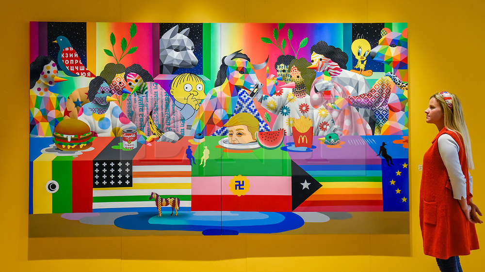 """© Licensed to London News Pictures. 04/10/2019. LONDON, UK. A visitors views """"Last Supper II"""", 2019, by Okuda San Miguel at Moniker International Art Fair, an urban contemporary art fair taking celebrating its 10 year anniversary in the UK.  The fair is  place at Chelsea's Sorting Office air until 6 October 2019.  Photo credit: Stephen Chung/LNP"""